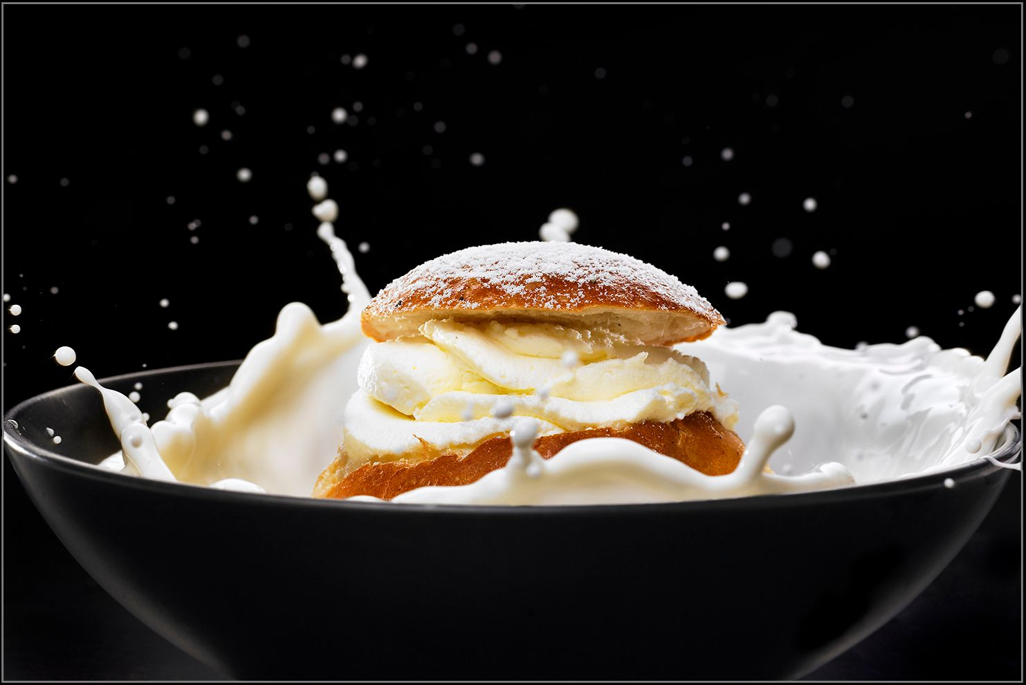 "Food Photography & styling by Fredrik Rege. ""Semla"" or ""Fastlagsbulle"" an old Swedish pastry."